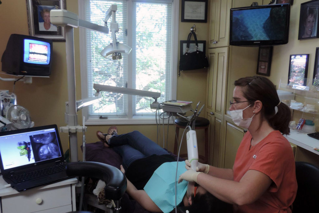 Digitally scanning patient's teeth